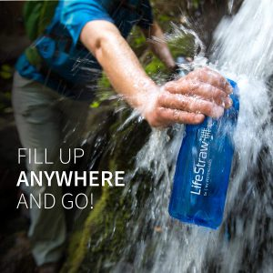 "person filling up Lifestraw water bottle in a water fall, with caption ""fill up anywhere you go"""